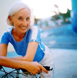 older woman riding a bike