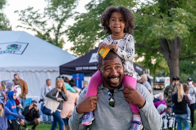 father and daughter at a music festival in San Diego