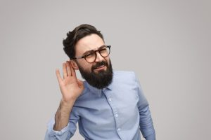 Bearded man listening closely